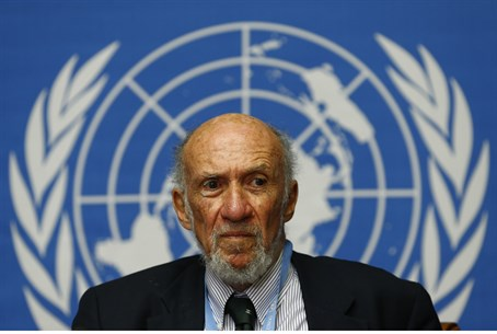 Richard Falk addresses a news conference on M