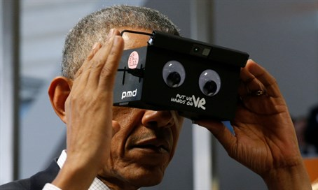 Obama tries virtual reality goggles in Germany