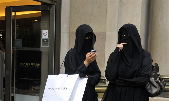 Muslim women in burqa face veils