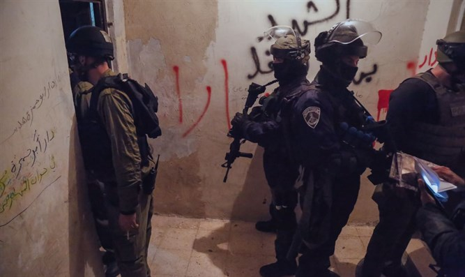 Police conduct searches in Shuafat neighborhood