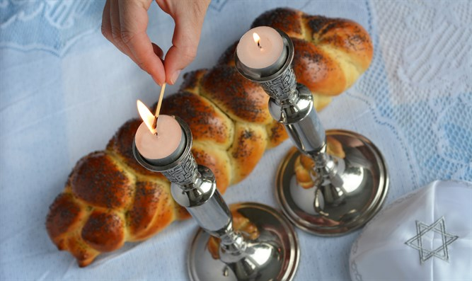 Shabbat candles and hallah bread