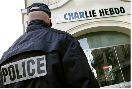 Police in front of Charlie Hebdo's Paris headquarters (file)