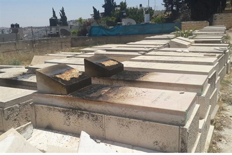 Torched gravestones on Mount of Olives