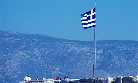 Flag of Greece flies atop Athens parliament building