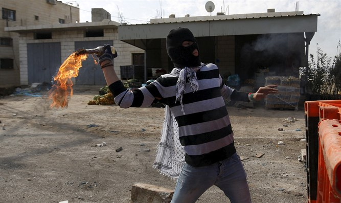 Arab throwing firebomb