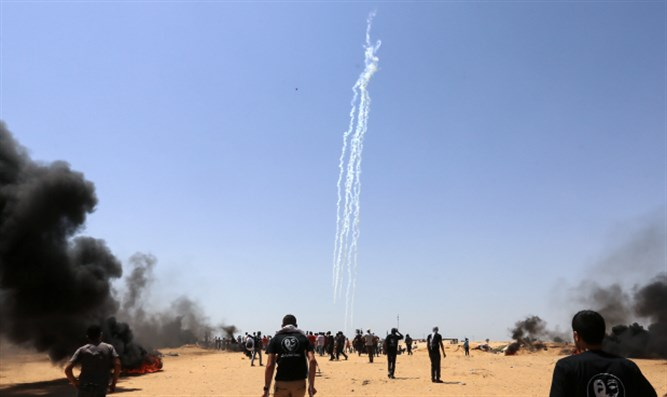 Rioters in Gaza near Israeli fence