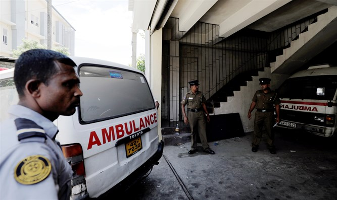 Ambulance carrying victims of Sri Lanka bombings backs into police morgue