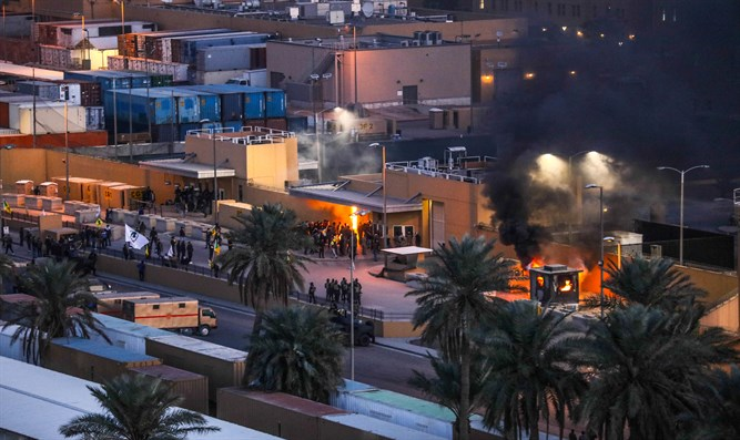 Protesters set fire to entry control point at the US Embassy in Baghdad