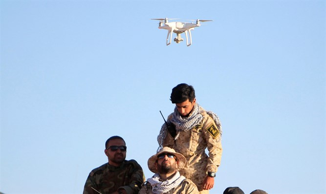 Drone hovers over Hezbollah fighters