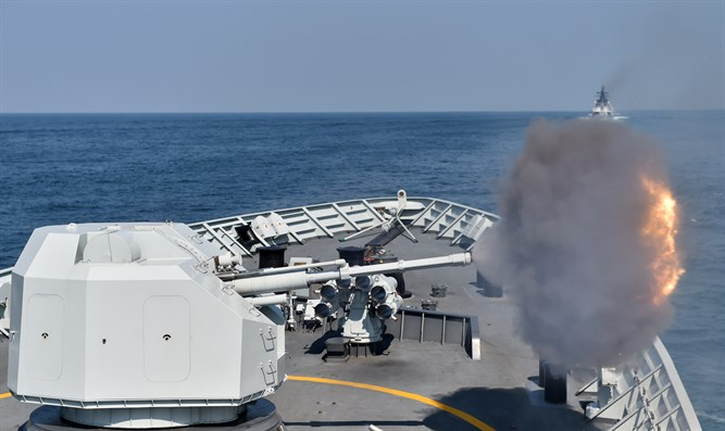 Artillery on China's Type-054A frigate Huangshan fires