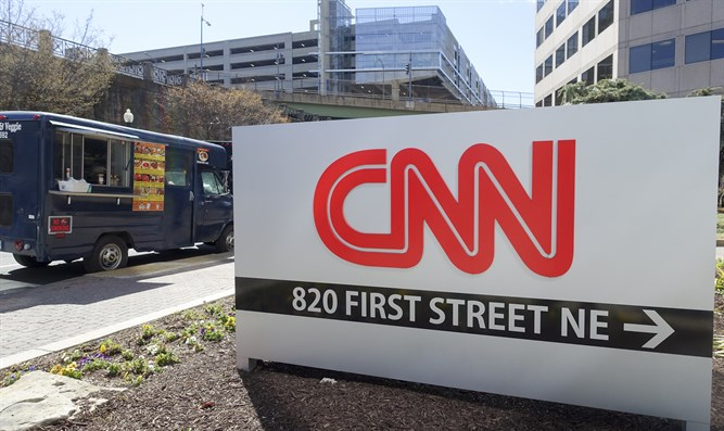sign pointing to cnn building